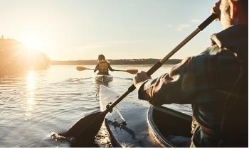 man and woman kayaking on a lake